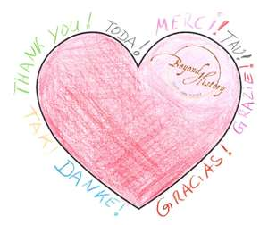 painted heart with the lettering Thank You! in various languages.